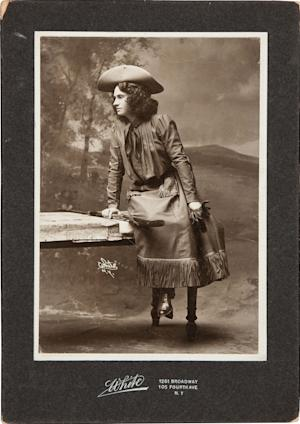 In this handout photo, provided by Heritage Auctions, Annie Oakley is seen as The Western Girl in a Cabinet Photo, signed and inscribed on verso. This is one of a series of photographs taken in 1902 or 1903 in New York. Relatives of Oakley are selling items that once belonged to the legendary sharpshooter including a Stetson hat, guns, letters and photographs. Heritage Auctions will offer up about 100 items related to Oakley on Sunday in Dallas.(AP Photo/Courtesy of Heritage Auctions)
