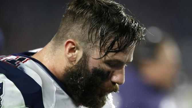 New England Patriots wide receiver Julian Edelman spits out some water on the sidelines as his team plays the Seattle Seahawks during the NFL Super Bowl XLIX football game in Glendale