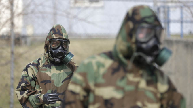 "Soldiers of the U.S. Army 23rd chemical battalion wear gas masks while attending a demonstration of their equipment during a ceremony to recognize the battalion's official return to the 2nd Infantry Division based in South Korea at Camp Stanley in Uijeongbu, north of Seoul, Thursday, April 4, 2013. The 23rd chemical battalion left South Korea in 2004 and returned with some 350 soldiers in Jan. 2013. The battalion will provide nuclear, biological and chemical detection, equipment decontamination and consequence management assistance to support U.S. and South Korean military forces. North Korea warned Thursday that its military has been cleared to attack the U.S. using ""smaller, lighter and diversified"" nuclear weapons, while the U.S. said it will strengthen regional protection by deploying a missile defense system to Guam. (AP Photo/Lee Jin-man)"