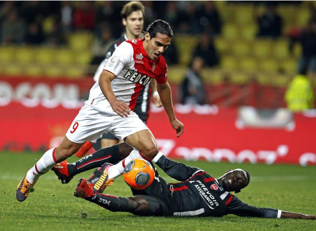 AS Monaco's Radamel Falcao is tackled by Saliou Ciss of Valenciennes during their French Ligue 1 soccer match at Louis II stadium