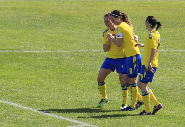 Sweden's Goransson celebrates her goal against Norway with her teammates Schelin and Moberg during their third place women's Algarve Cup soccer match in Lagos