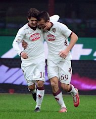 Torino&#39;s forward Riccardo Meggiorini (R) celebrates after scoring his second goal during the serie A match between Inter Milan and Torino on January 27, 2013 at the San Siro stadium in Milan. The match ended in a 2-2 draw