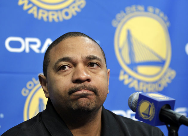 FILE - In this Dec. 1, 2011 file photo, Golden State Warriors head coach Mark Jackson listens during an NBA basketball news conference in Oakland, Calif. Jackson has confirmed that he and his family w
