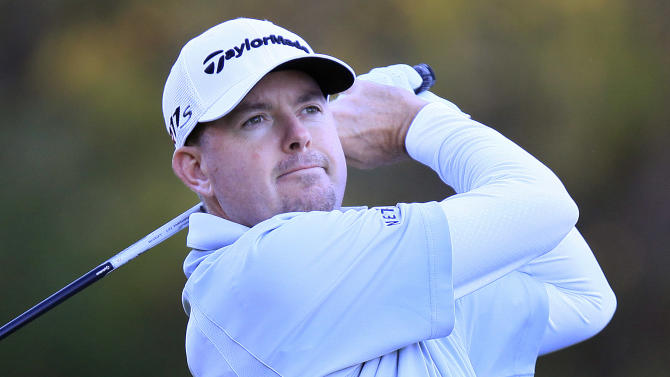Robert Garrigus hits his tee shot on the tenth hole during the first round of the Children's Miracle Network Hospitals Classic golf tournament in Lake Buena Vista, Fla., on Thursday, Nov. 8, 2012. (AP Photo/Julie Fletcher)