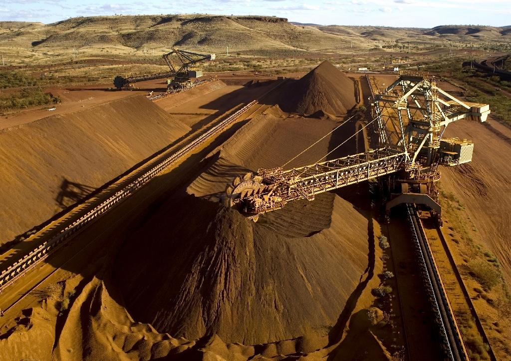 Rio Tinto iron ore output slows, but still rising as prices plunge