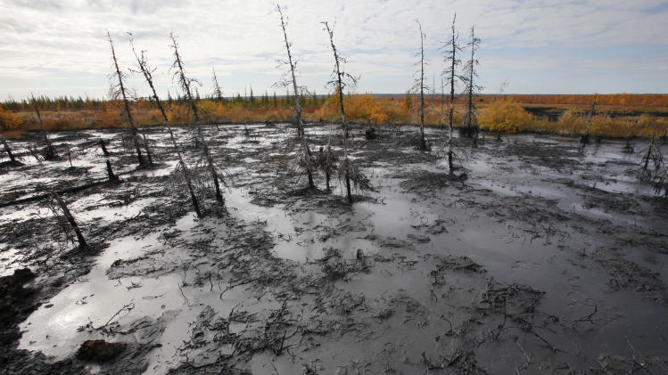 In this Saturday, Sept. 10, 2011 photo an oil spill seen near the town of  Usinsk, 1500 km (930 miles) northeast of Moscow, Russia.  Komi is one of Russia's largest and oldest oil provinces but ruptures in aging pipelines and leaks from decommissioned oil wells make oil spills in the region routine. (AP Photo/Dmitry Lovetsky)