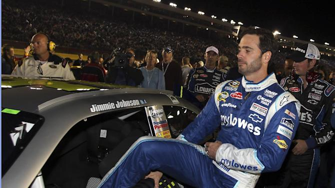 Jimmie Johnson climbs into his car before the NASCAR Bank of America 500 Sprint Cup series auto race in Concord, N.C., Saturday, Oct. 13, 2012. (AP Photo/Bob Jordan)