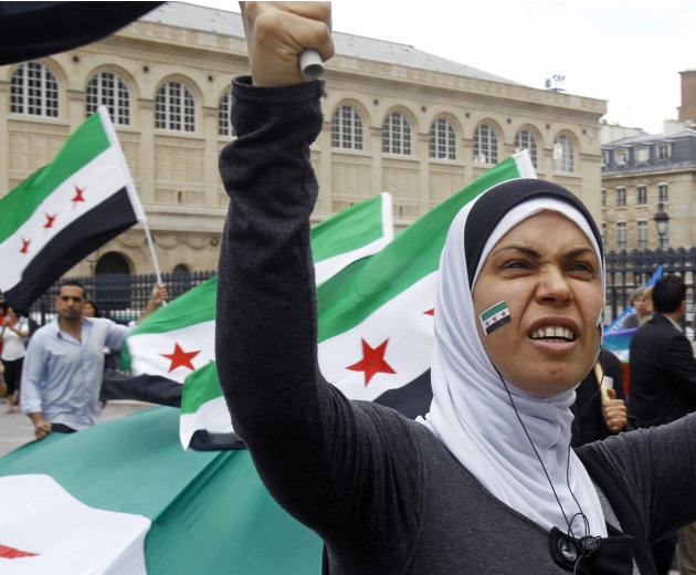 A March for the Syrian People gathers protesters in front of the Pantheon in Paris, Saturday, July 7, 2012. Demonstrators waving Syrian flags took to the streets to protest against Syrian regime of Ba