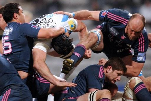 Stade Francais' flanker George Smith (C) and flanker Antoine Burban(R) fight in a ruck during the European Challenge Cup quarter final rugby union match Stade Francais vs. Exeter at the Charlety stadi
