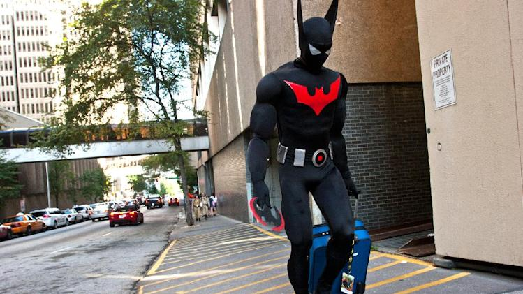 An unidentified Dragon Con attendee, dressed as Batman, walks to his hotel in downtown in Atlanta, on Friday, Aug. 31, 2012. The annual science fiction and fantasy convention drew big crowds and had more than 30,000 pre-registered attendees. (AP Photo/Ron Harris)
