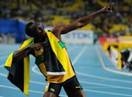 "Usain Bolt, pictured in 2011, has been declared fully fit to defend his three Olympic titles, with the Jamaican team doctor insisting that the sprint king's performance is ""on track"""