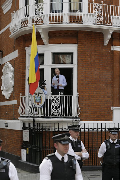 "Julian Assange, founder of WikiLeaks makes a statement from a balcony of the Equador Embassy in London, Sunday, Aug. 19, 2012.  Assange called on United States President Barack Obama to 'end a ""witch"