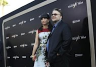 "Director Guillermo del Toro and his wife Lorenza pose at the premiere of ""Pacific Rim"" at Dolby theatre in Hollywood, California July 9, 2013. The movie opens in the U.S. on July 12. REUTERS/Mario Anzuoni"