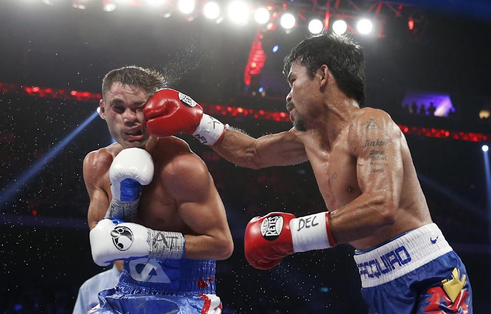 Pacquiao knocks Algieri down 6 times, dominates