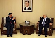Syrian Foreign Minister Walid al-Muallem (R) meets with Chinese Envoy Lee Huaxin in Damascus. Muallem said that Damascus was ready to cooperate with a Chinese initiative to end the bloodshed and begin dialogue between the regime and the opposition