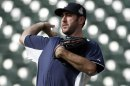 Detroit Tigers Pitcher Justin Verlander Throws During A Workout At Comerica Park In Detroit, Monday, Oct. 22, 2012. When Dave Dombrowski First Took Over As President Of The Detroit Tigers, They Lost 225 Games His First Two Seasons. But In 2004, Detroit Drafted Justin Verlander, The First Step Toward Building One Of Baseball&#039;s Glamour Teams In The Heart Of The Motor City. The Tigers Will Play The Winner Of The San Francisco Giants-St. Louis Cardinals National League Championship Series In The World Series. (AP Photo/Paul Sancya)