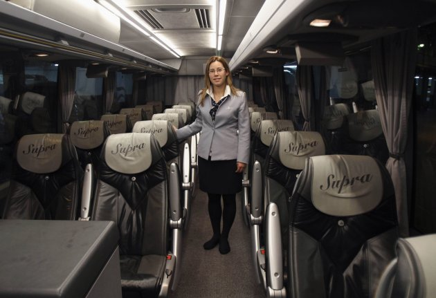 Tania Leon, a 29 year-old stewardess, poses for a picture inside a bus in Santiago de Compostela