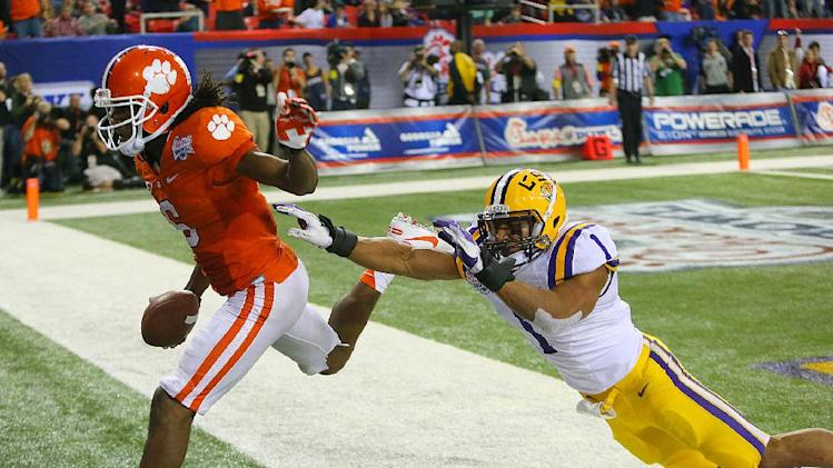 Clemson wide receiver DeAndre Hopkins gets past LSU safety Eric Reid for a touchdown reception to cut the LSU lead to 24-22 in the fourth quarter of the Chick-fil-A NCAA college football game in Atlanta on Monday, Dec. 31, 2012. Clemson won 25-24. (AP Photo/Atlanta Journal & Constitution, Curtis Compton) GWINNETT OUT  MARIETTA OUT  LOCAL TV OUT (WXIA, WGCL, FOX 5)