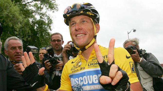 FILE - This july 24, 2005 file photo shows overall leader Lance Armstrong signaling seven for his seventh straight win in the Tour de France cycling race, at the start of the 21st and final stage of the race between Corbeil-Essonnes, south of Paris, and the French capital. The chief of world cycling's governing body is questioning why American anti-doping authorities have not sent him the file of evidence that prompted them to erase Lance Armstrong's seven Tour de France titles and ban him for life. International Cycling Union President Pat McQuaid on Saturday, Sept., 22, 2012, said the United States Anti-Doping Agency had not given the UCI a date to expect the details, and he sounded impatient to receive them. (AP Photo/Alessandro Trovati, File)