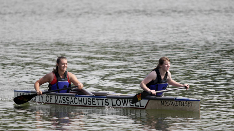 IMAGE DISTRIBUTED FOR ASCE - Civil engineering students from University of Massachusetts Lowell paddle it out in their quest for 'America's Cup of Civil Engineering' during the American Society of Civil Engineer's 26th Annual National Concrete Canoe Competition, Saturday, June 22, 2013 in Urbana, Ill. The University of Illinois Urbana-Champaign hosted the the three day event. (AJ Mast / AP Images for ASCE)