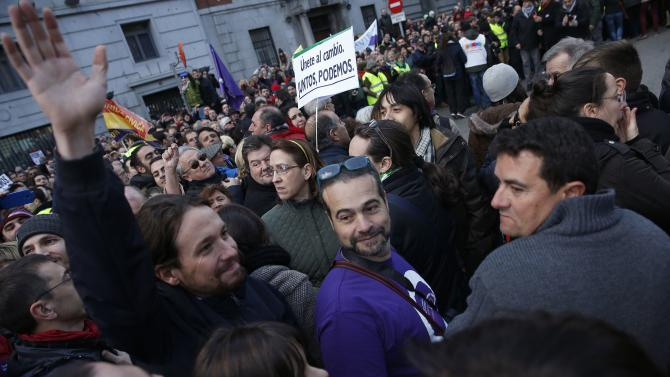 "Pablo Iglesias, leader of Spain's party ""Podemos"" (We Can) waves as he attends a rally called by Podemos in Madrid"