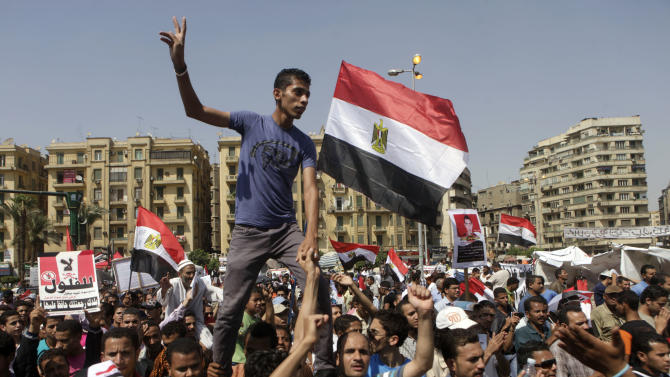 Egyptian protesters shout slogans at a protest in Tahrir Square, Cairo, Egypt Friday, June 8, 2012. Hundreds gathered in Cairo's Tahrir Square, the focal point of Egyptian uprising, to demonstrate against presidential candidate Ahmed Shafiq, Hosni Mubarak's last prime minister, ahead of a run-off vote.(AP Photo/Amr Nabil)