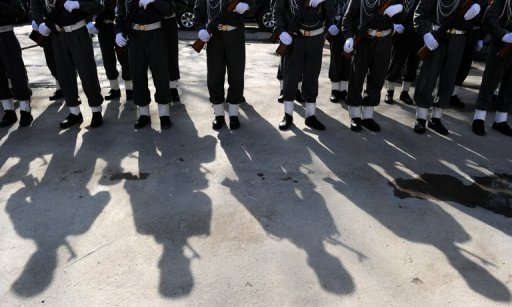 "<p>This file photo shows Afghan police standing to attention during a ceremony at the main police headquarters in Kabul, on January 25, 2010. A female Afghan police officer on Monday shot dead a foreign civilian adviser in Kabul police HQ, in the first ""insider"" attack to be carried out by a woman.</p>"
