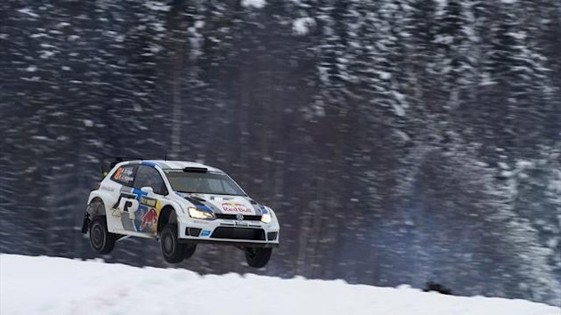 France's Sebastien Ogier and his co-driver Julien Ingrassia steer their Volkswagen Polo R WRC during the fifth stage of the Sweden Rally of the second round of the FIA World Rally Championship in Hagfors, Sweden February 8, 2013. (Reuters)