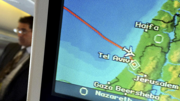 A navigation screen on the plane of U.S. Secretary of State John Kerry shows its approach to Tel Aviv, Israel, Wednesday, July 23, 2014. Kerry defied a Federal Aviation Administration order temporarily halting flights into Tel Aviv Wednesday as part of his latest effort to broker a truce between Israel and Hamas that would halt fighting in the Gaza Strip. (AP Photo/Pool)