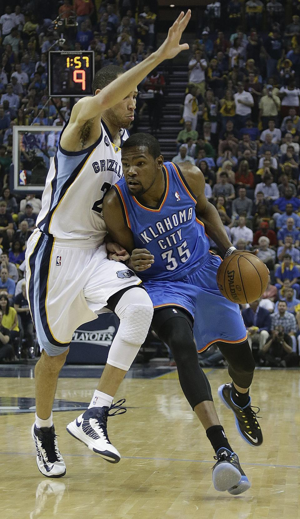 Memphis Grizzlies' Tayshaun Prince defends against Oklahoma City Thunder small forward Kevin Durant (35) during the the first half of Game 4 in a Western Conference semifinal NBA basketball playoff series in Memphis, Tenn., Monday, May 13, 2013. (AP Photo/Danny Johnston)