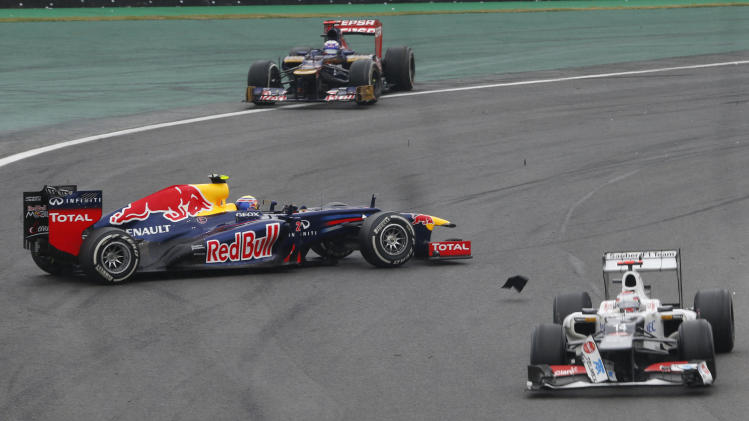 Red Bull driver Mark Webber, left, of Australia, looses control of his car after colliding with Sauber driver Sergio Perez of Mexico, right, during the Formula One Brazilian Grand Prix at the Interlagos race track in Sao Paulo, Brazil, Sunday, Nov. 25, 2012. (AP Photo/Silvia Izquierdo)