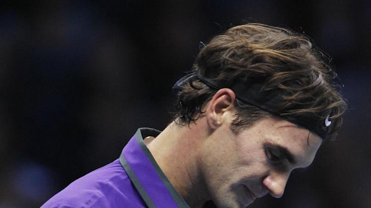 Roger Federer of Switzerland gestures as he plays Novak Djokovic of Serbia during their ATP World Tour Tennis singles final match in London, Monday, Nov. 12, 2012. (AP Photo/Sang Tan)
