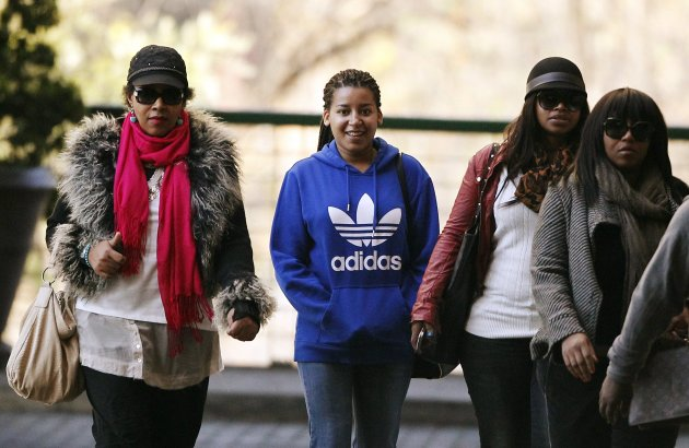 Zenani Mandela, daughter of former South African President Nelson Mandela, arrives with Mandela's granddaughters Zoleka and Zaziwe Manaway, at a Pretoria hospital where he is being treated