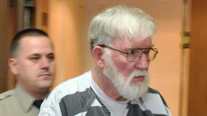 In this Feb. 2, 2012 file photo, Carl V. Ericsson, 73, is led into a Lake County courtroom for a bond hearing on a first-degree murder charge in Madison, S.D. Ericsson was sentenced to life in prison Friday, June 15, 2012, after pleading guilty but mentally ill last month to second-degree murder. Ericsson was charged in the Jan. 31 killing of retired Madison High School teacher and track coach Norman Johnson, who KSs shot twice in the face. (AP Photo/Dirk Lammers)