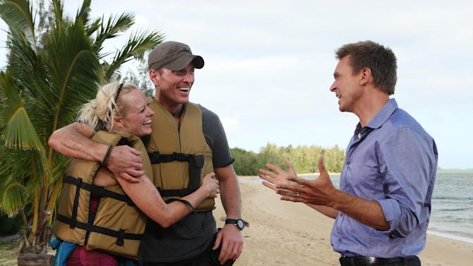 """In this undated image released by CBS, Rachel and Dave Brown are shown with host Phil Keoghan, right, after winning on the latest edition of """"The Amazing Race,"""" which aired Sunday, May 6, 2012 on CBS.  The Madison, Wis., couple outlasted 10 other couples to win the $1 million grand prize.  Dave Brown is in the Wisconsin Army National Guard and served in Iraq. He also teaches military science at the University of Wisconsin-Madison. Rachel Brown is a project manager for a software company. Because Dave has been deployed overseas, and Rachel frequently travels on business, they say one of the most rewarding parts of the competition was the chance to spend so much time together. (AP Photo/CBS, Monty Brinton)"""