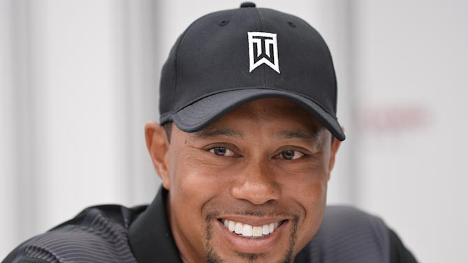 US golfer Tiger Woods smiles while speaking to the press at the Congressional Country Club in Bethesda, Maryland on June 24, 2014