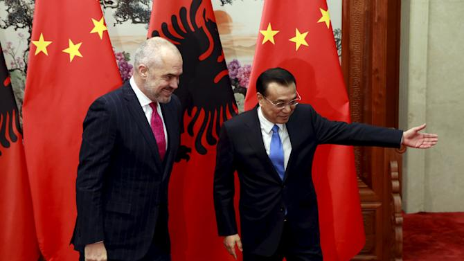 China's Premier Li Keqiang shows the way for Albanian Prime Minister Edi Rama during their meeting, on the sidelines of the 4th Meeting of Heads of Government of China and Central and Eastern European Countries, at the Great Hall of the People in Beijing