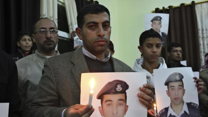 Brother of Islamic State captive Jordanian pilot al-Kasaesbeh takes part in a rally in his support at the family's headquarters in the city of Karak