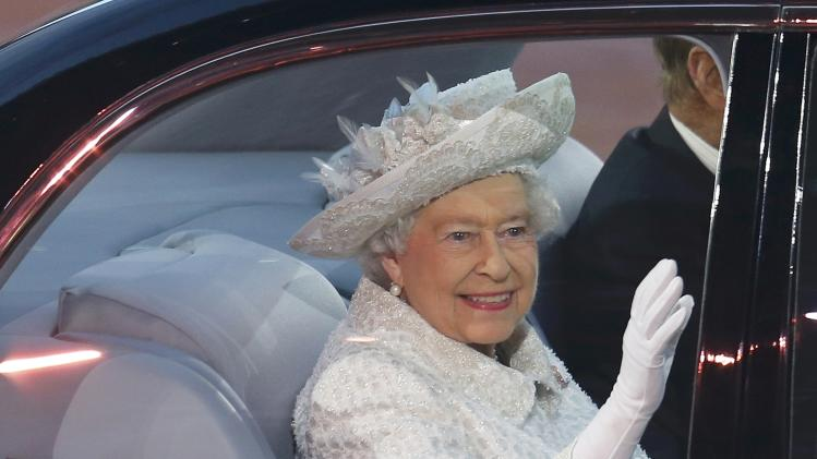 Britain's Queen Elizabeth waves as she arrives during the opening ceremony for the 2014 Commonwealth Games at Celtic Park in Glasgow, Scotland