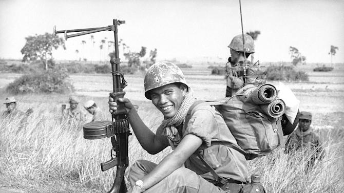 "FILE-This Sept. 20, 1970, file photo taken by Associated Press photographer, Huynh Cong ""Nick"" Ut, shows a Cambodian soldier on an operation in Vietnam. It only took a second for Ut to snap the iconic black-and-white image of Phan Thi Kim Phuc after a napalm attack in 1972, but it communicated the horrors of the Vietnam War in a way words could never describe, helping to end one of America's darkest eras. (AP Photo/Nick Ut)"