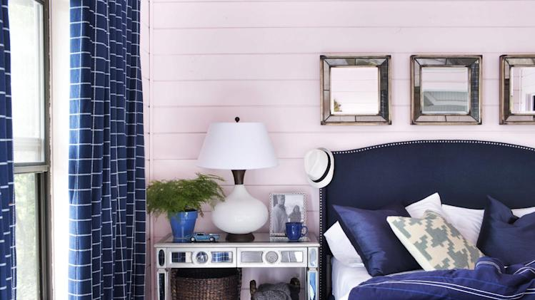 In this photo provided by Brian Patrick Flynn, a guest bedroom by the designer Flynn featured on Hayneedle.com uses a muted shade of blush on the walls and ceiling. Flynn suggests blush tones will become popular in 2014, but to add a fresh touch, they'll be paired with masculine tones such as navy blue. (AP Photo/Hayneedle.com, Sarah Dorio)