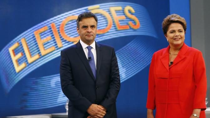 Presidential candidates Neves of Brazilian Social Democratic Party and Rousseff of Workers Party pose before a television debate in Rio de Janeiro