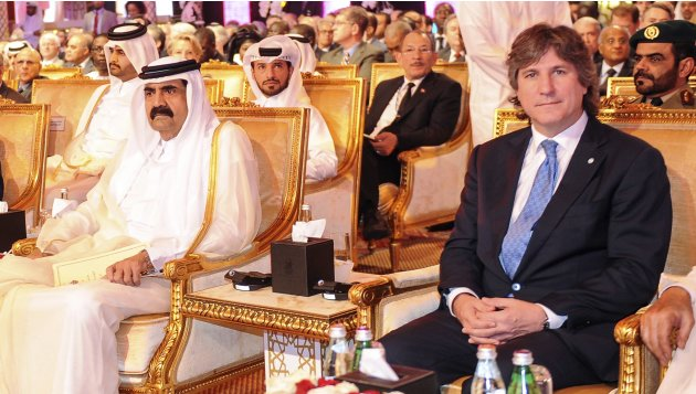 Emir of Qatar Sheikh Hamad bin Khalifa al-Thani and other officials attend the opening of the Doha Forum