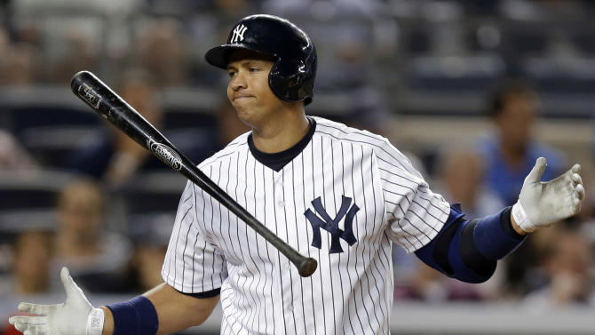 FILE - In this Aug. 13, 2013, file photo, New York Yankees' Alex Rodriguez reacts after striking out in the seventh inning of a baseball game against the Los Angeles Angels in New York. Rodriguez has accepted his season-long suspension from Major League Baseball, the longest penalty in the sport's history related to performance-enhancing drugs. Rodriguez withdrew his lawsuits against MLB, Commissioner Bud Selig and the players' association to overturn his season-long suspension on Friday, Feb. 7, 2014. (AP Photo/Kathy Willens, File)