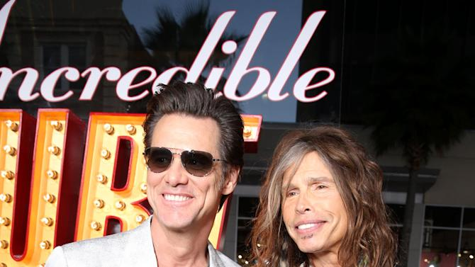 Jim Carrey and Steven Tyler at New Line Cinema's World Premiere of 'The Incredible Burt Wonderstone' held at Grauman's Chinese Theatre on Monday, Mar., 11, 2013 in Los Angeles. (Photo by Eric Charbonneau/Invision for New Line Cinema/AP Images)