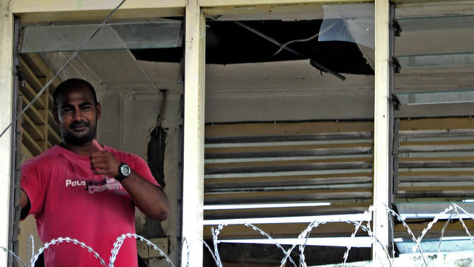 Australian death row convict Myuran Sukumaran looks out through a window of the prison tower at Kerobokan Prison in Denpasar, Indonesia, Friday, Feb. 24, 2012. Prison riot that erupted late Tuesday at the Kerobokan jail, which houses more than 1,000 drug traffickers, sex offenders and other violent criminals, was triggered by the stabbing of an inmate during a brawl a week ago. The prisoners blamed lax security for allowing a knife into the prison. (AP Photo)