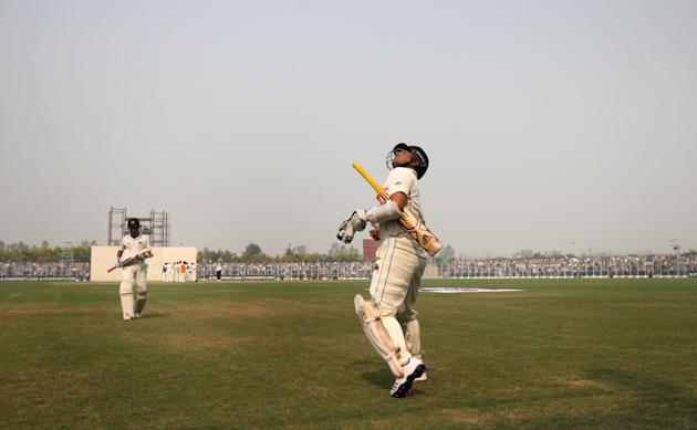 Master blaster Sachin Tendulkar enters the field during Ranji Trophy match between Haryana and Mumbai played at Bansi Lal Cricket Stadium in Rohtak on Oct.29, 2013. (Photo: IANS)