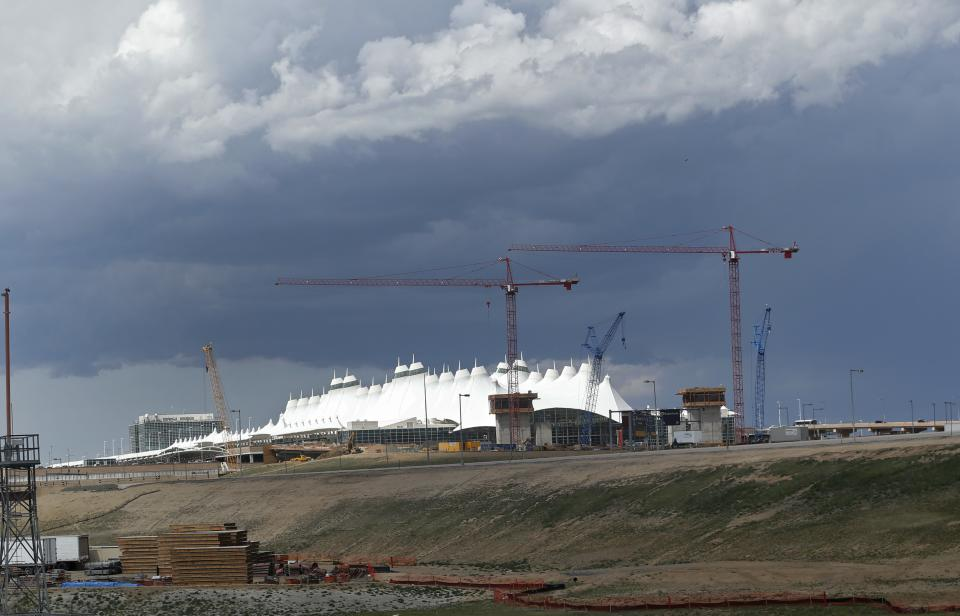 Storm clouds are seen over Denver International Airport on Tuesday, June 18, 2013, where a tornado touched down and forced passengers and employees into shelters. No one was injured and there was no apparent damage. (AP Photo/Ed Andrieski)