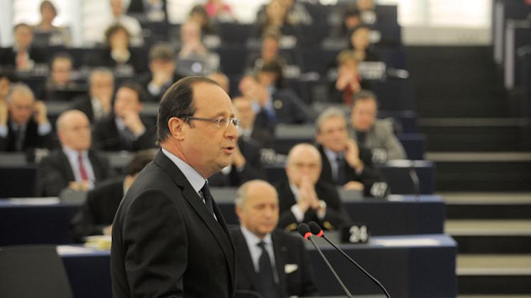 French president Francois Hollande delivers his speech at the European Parliament Tuesday, Feb. 5, 2013, in Strasbourg, eastern France.  Hollande warns of a tough European Union summit later this week if countries including Britain continue to demand drastic cuts to the EU budget while refusing to make concessions themselves.  (AP Photo/Christian Lutz)