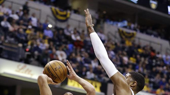 Atlanta Hawks guard Devin Harris (34) is fouled by Indiana Pacers forward Gerald Green in the first half of Game 2 of a first-round NBA basketball playoff series in Indianapolis, Wednesday, April 24, 2013. (AP Photo/Michael Conroy)